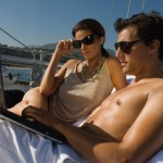 rich-couple-yatch-with-laptop2